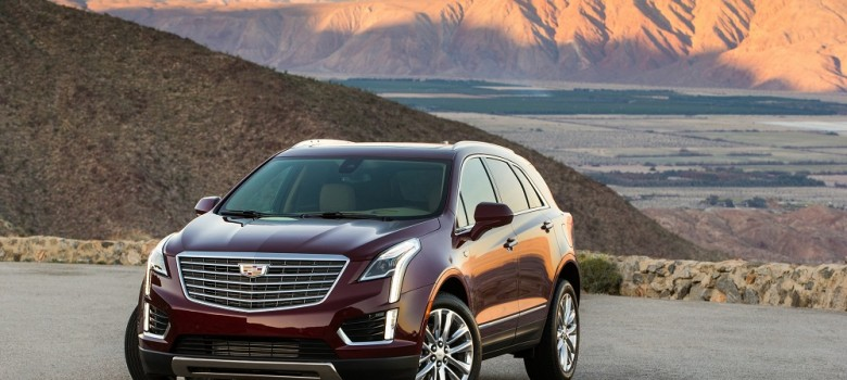 The first-ever 2017 Cadillac XT5 is a comprehensively upgraded luxury crossover and the cornerstone of a new series of crossovers in the brand's ongoing expansion. The XT5 further builds on Cadillac's trademark attributes of distinctive, sophisticated and agile vehicles. Pictured: 2017 Cadillac XT5 Platinum; Exterior paint shown in in Red Passion Tintcoat; Interior environment shown in Maple Sugar with Jet Black accents and Satin Rosewood wood trim.
